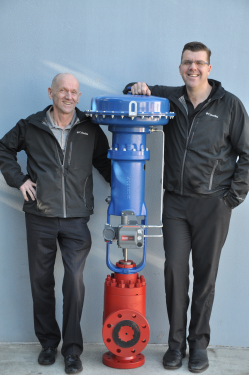 Paul and Andrew standing next to a completed Taylor RB-4 Choke Valve